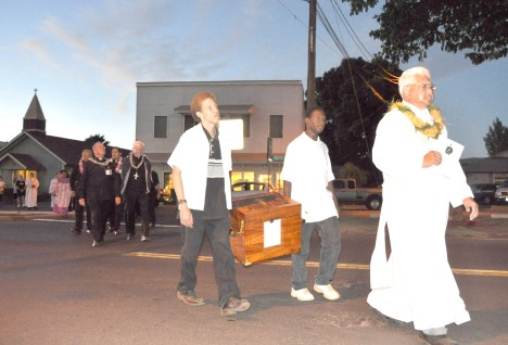 The reliquary carrying the right heel bone relic of Saint Damien leaves St. Sophia Friday evening on its way to prayer service at Kaunakakai Ballfield led by Clarence DeCaires, deacon of St. John Vianney Parish, Kailua