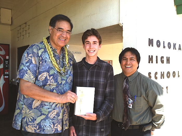 Mufi Hanneman awards Michael Kikukawa with the Harvard book Award last year when Michael was a junior, along with Molokai High School Principal Stan Hao.
