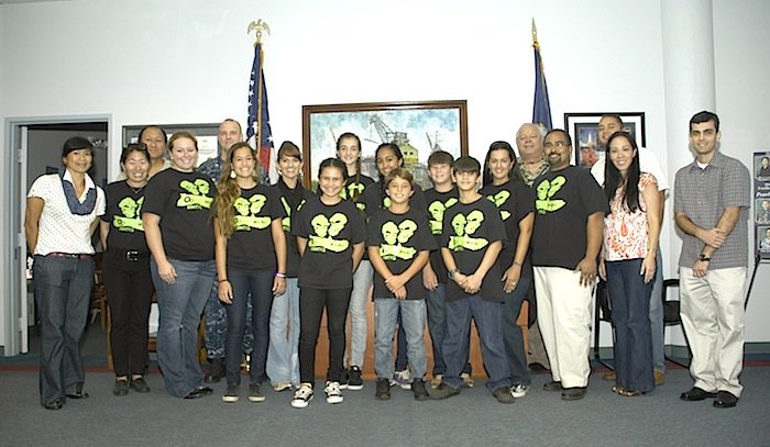 From left: Shipyard Public Affairs Officer Jensin Sommer, Molokai Middle School robotics team chaperone Kimberly Svetin, Shipyarder and former Molokai resident Ivan Shizuma, chaperone Jennifer Whitted, Shipyard Commander Capt. Brian Osgood, team mentor Sara Jenkins, chaperone Louise Manley, team members Kaitlyn DeRouin, Lily Jenkins, Katy Domingo, Caele Manley, Erik Svetin, Noah Keanini, Chaperone Heidi Jenkins, Shipyarder and former Molokai resident Henry Keanini, Chaperone David Gonzales, shipyarder and former Molokai resident Kaiki Ragragola, and shipyarders Lauren Thompson and Eric Petran. (U.S. Navy photo by David Tomiyama)