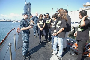 An officer from USS Hawaii (SSN 776) explains facts on the Virginia submarine to Molokai Middle School students during a tour at Joint Base Pearl Harbor-Hickam, Nov. 30.(U.S. Navy photo by David Tomiyama)