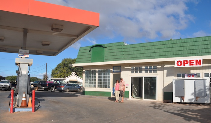 Susan and Tim Forsberg in front of the new Molokai Fish and Dive gas station, which opened this morning at 8 a.m.