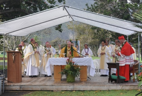 Bishop of Honolulu Larry Silva leads the celebratory mass for Saint Marianne Cope. He is surrounded by visiting bishops.