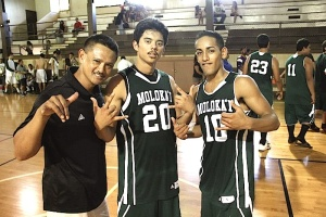 Head Coach Lester Delos Reyes, David Rapanot and Hauoli Faleali'i at Kaunakakai Gym Saturday. Photo by Rick Schonely.