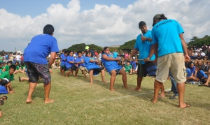 The Kualapuu fifth grade Huki Huki team prepares to win the finals at Saturday's Makahiki games. Kualapuu won six out of seven grades in the Huki Huki competition.