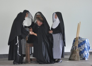 "In the play ""November's Song,"" Mother Marianne can be seen ministering to Father Damien who had recently been stricken with leprosy."